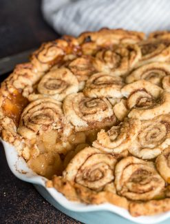 Cinnamon Roll Apple Pie with slice out