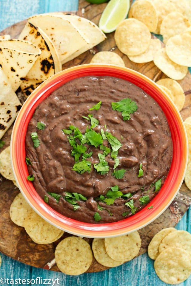 A close up of a bowl of refried beans