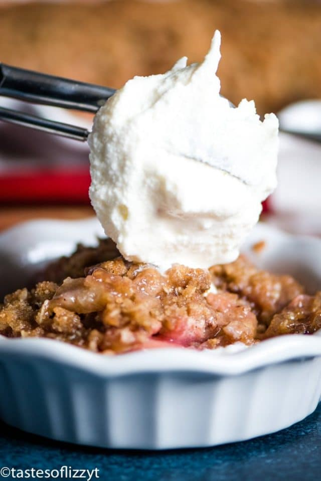 A close up of a rhubarb crumble with ice cream