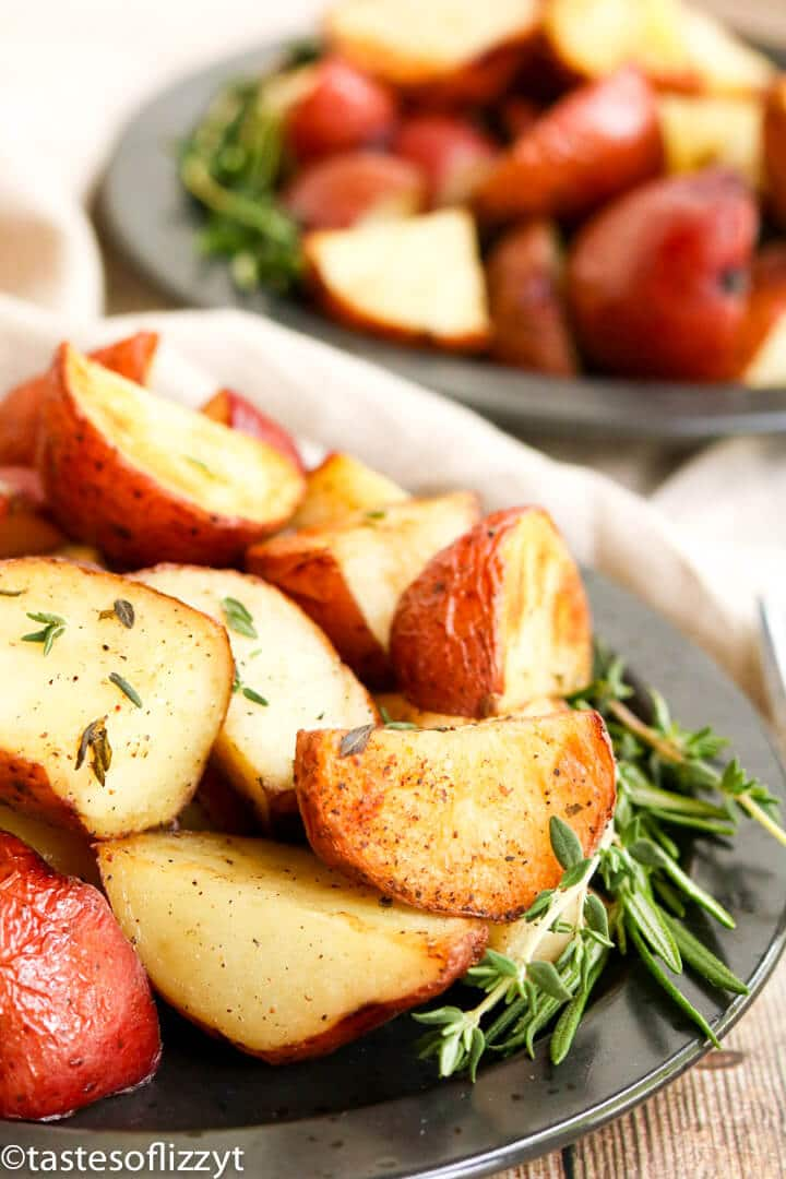 A plate of food, with roasted potatoes