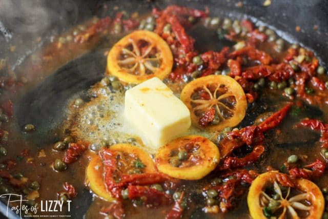 lemons, butter and tomatoes in a skillet
