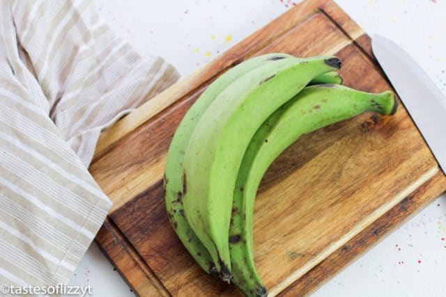 green plantains on a cutting board