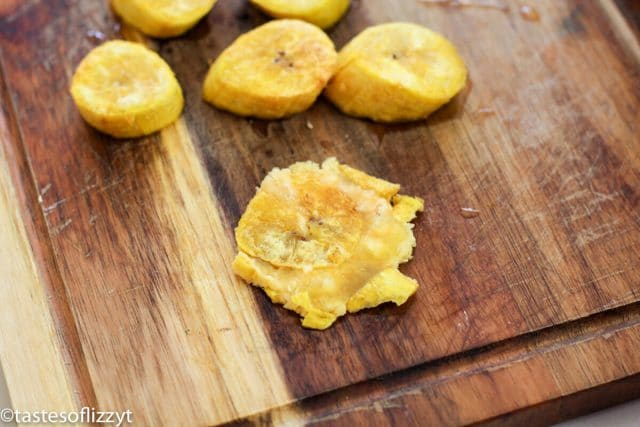 mashed plantains on cutting board