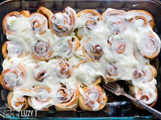 frosted cinnamon rolls with one missing