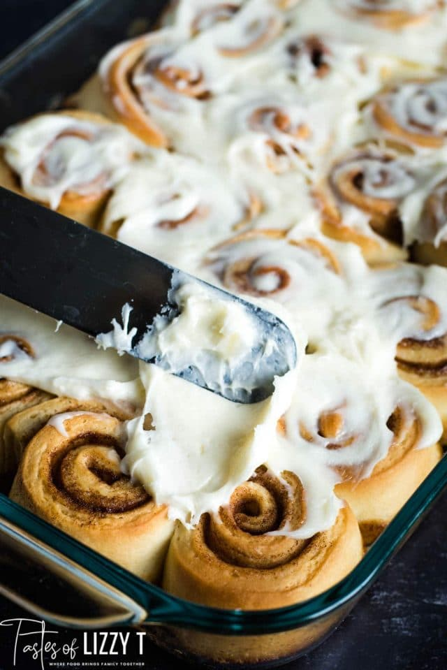 spreading frosting on mini cinnamon rolls