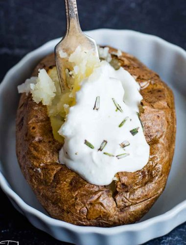 Air Fryer Baked Potato with sour cream and butter
