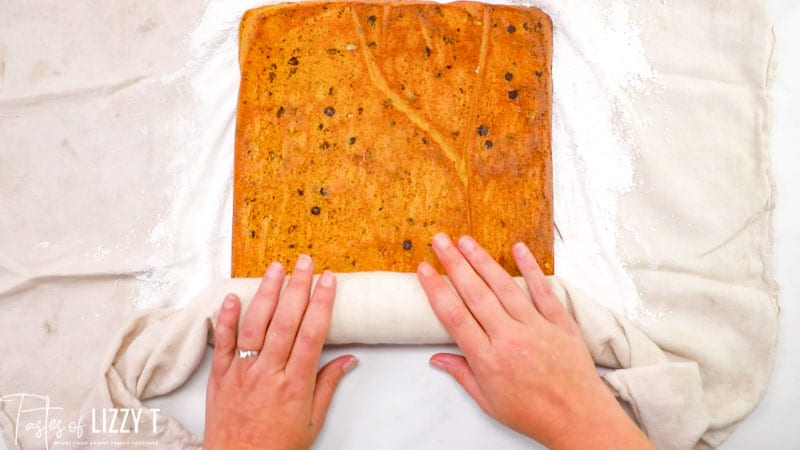 rolling a pumpkin cake roll