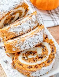 sliced Chocolate Pecan Pumpkin Roll on a plate