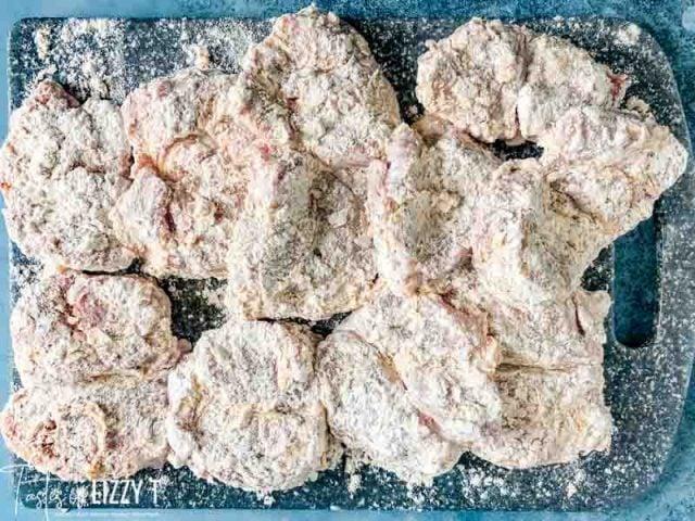 A close up of floured pork tenderloin