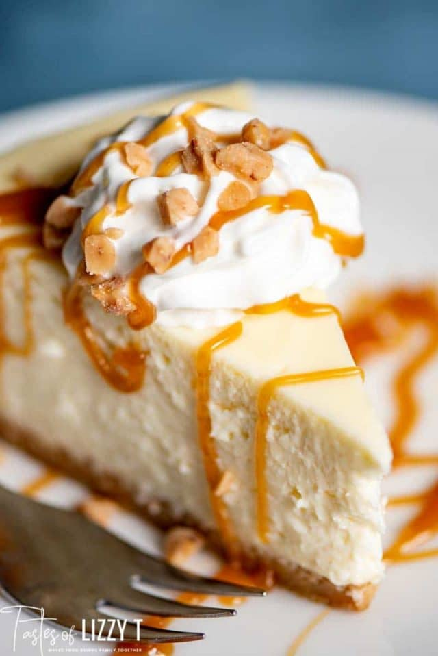 A piece of cheesecake on a plate, with caramel