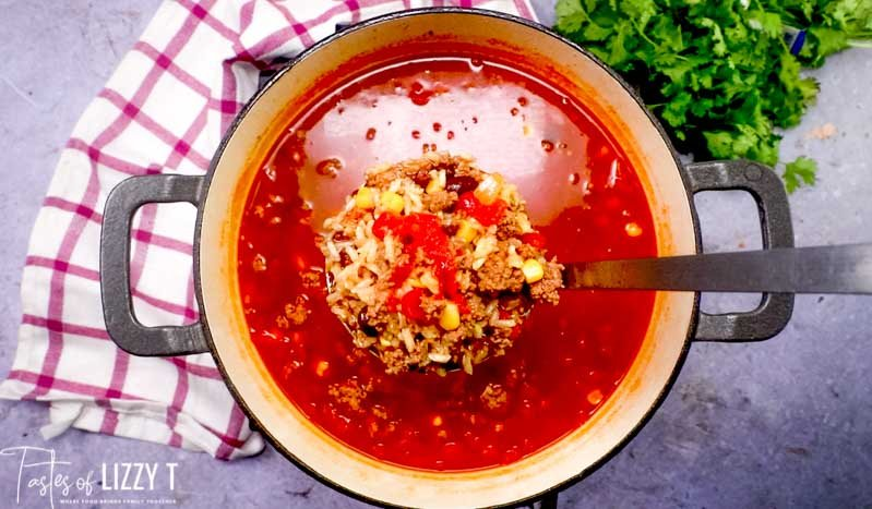mexican rice soup in a ladle