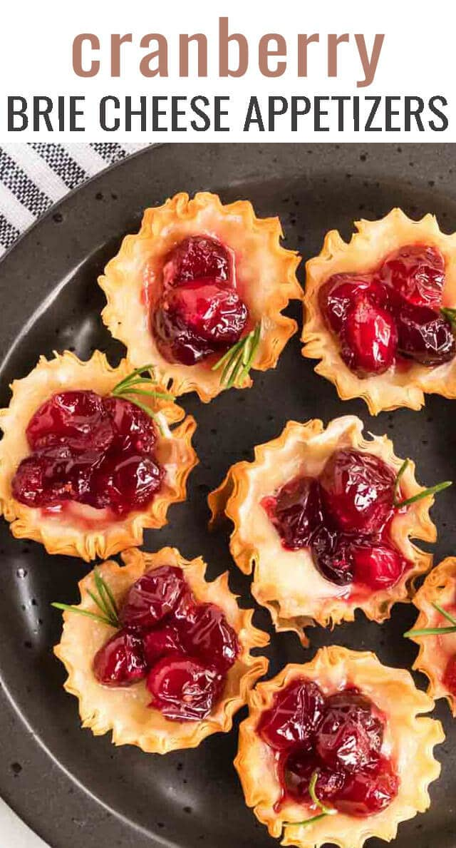 Cranberry brie bites are the best phyllo cups appetizer recipe to serve at holiday parties! You'll love the creamy tarts as a first course or dessert! via @tastesoflizzyt