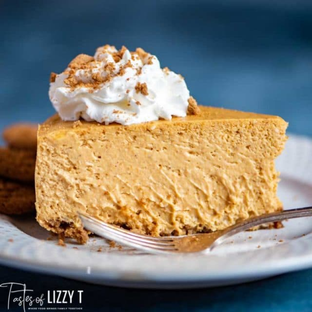 creamy Pumpkin Cheesecake with gingersnaps on a plate