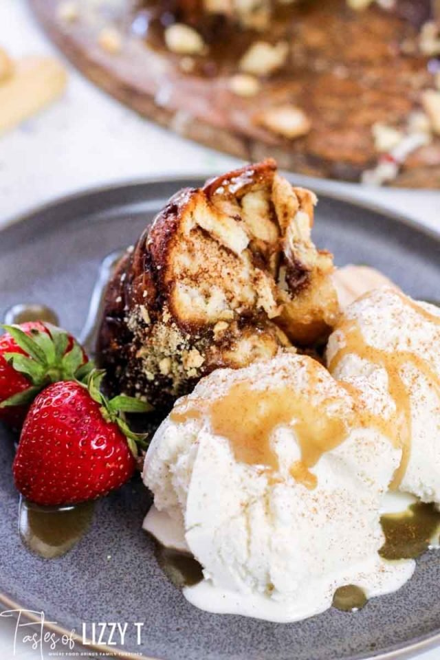 A close up of a piece of monkey bread and ice cream on a plate