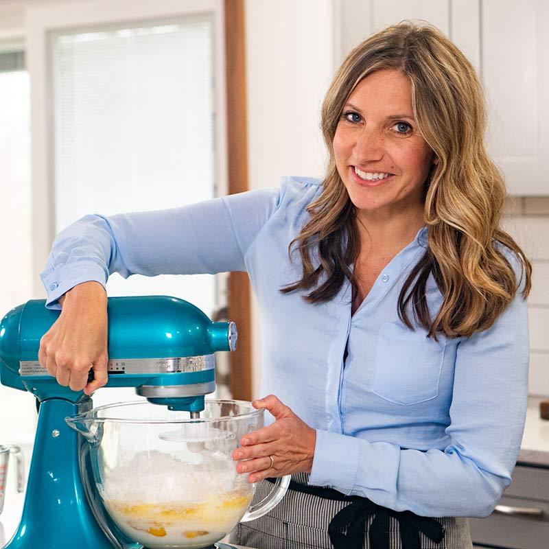 A woman holding a mixer