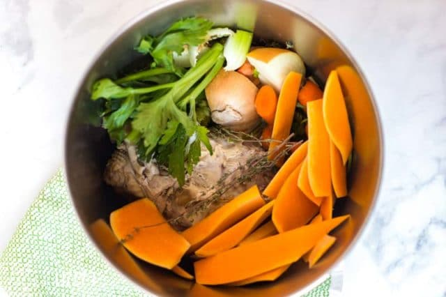 A pot of food, with vegetables and turkey