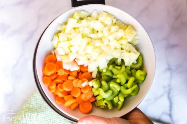 pan with onions, celery and carrots