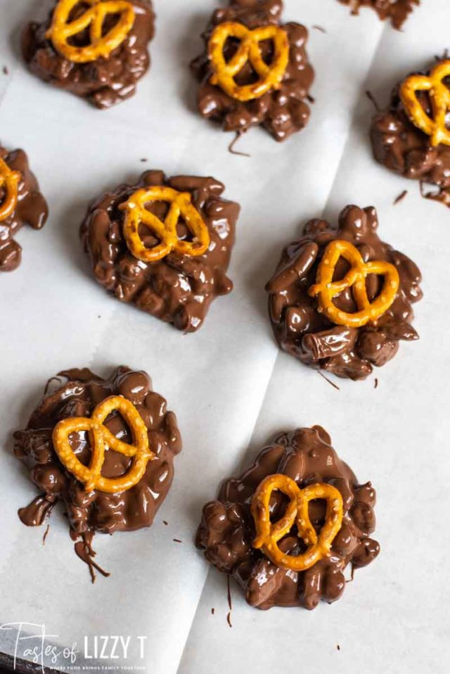 chocolate candies with pretzels on parchment paper
