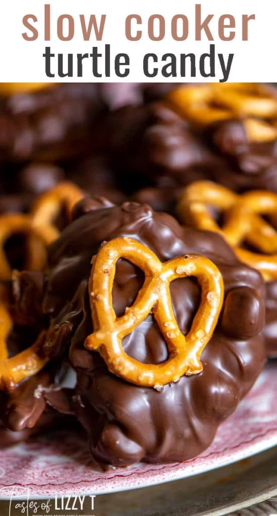 A close up of a chocolate candy with pretzel