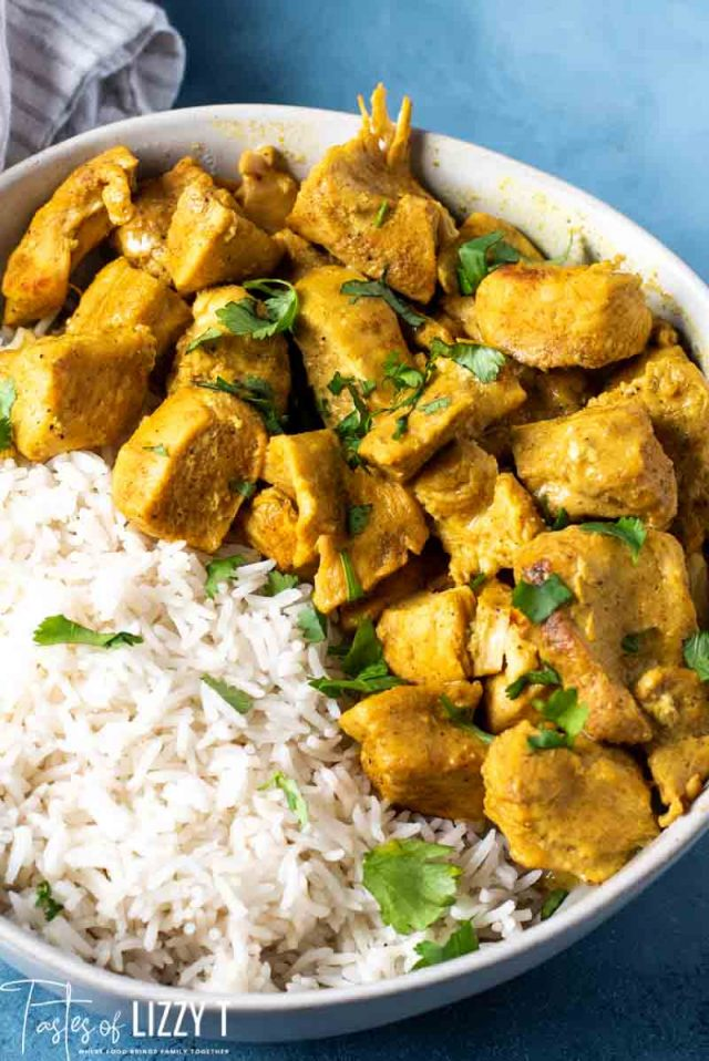 A plate full of food, with Curry and Chicken