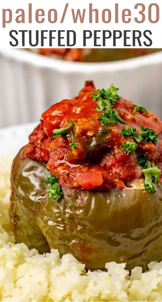 Paleo Stuffed Peppers are filled with seasoned ground sirloin and slow cooked to perfection. Served with cauliflower rice and smothered in spaghetti sauce. #paleo #whole30 #stuffedpeppers #peppers via @tastesoflizzyt