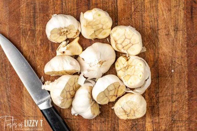 A wooden cutting board, with Garlic