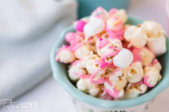 A close up of a bowl of food, with Popcorn and Candy