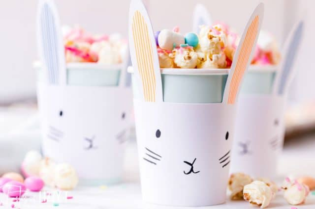 A close up of a cup of easter popcorn