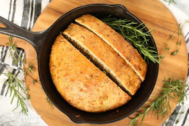 skillet with sliced rosemary bread