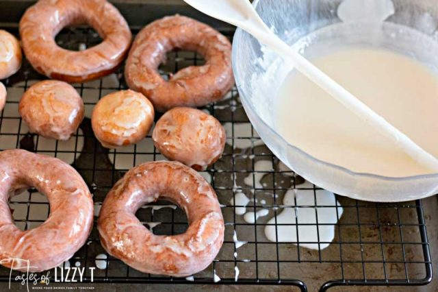 bowl of glaze with homemade donuts