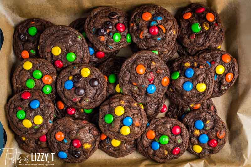 m&m chocolate cookies on parchment paper