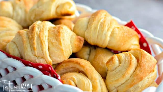 horizontal image of a basket of crescent rolls