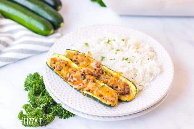 plate with rice and two zucchini boats