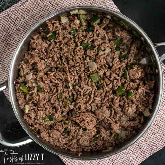 ground beef peppers and onions in a skillet