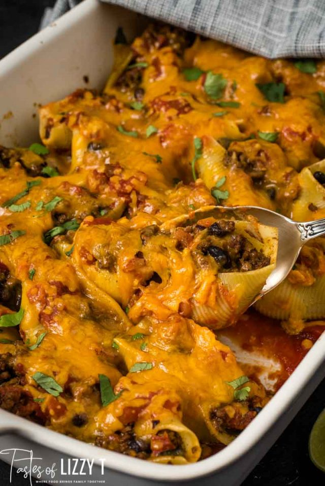 cheese topped taco stuffed shells in casserole