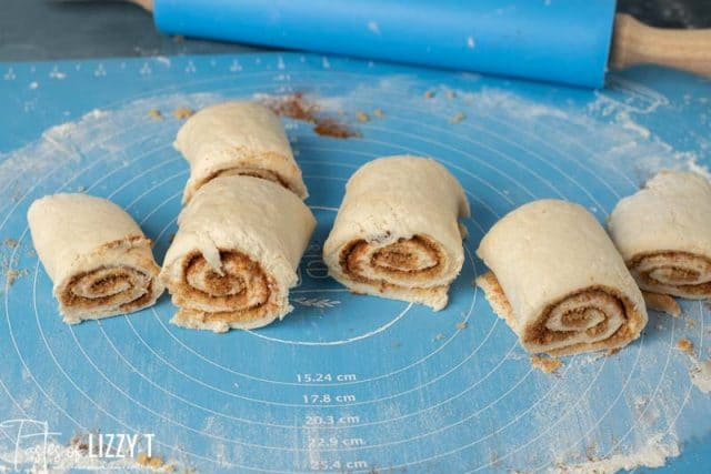 unbaked bisquick cinnamon rolls on a pastry mat