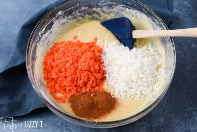 carrots, coconut and cinnamon on cake batter