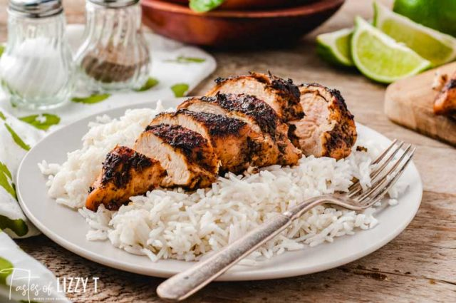 blackened chicken on a plate with rice