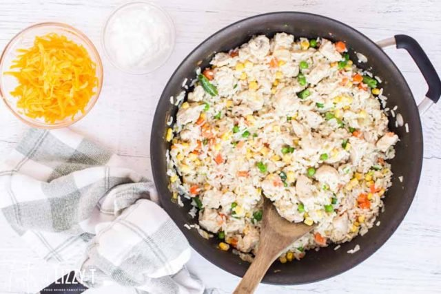 rice, chicken and veggies in a skillet