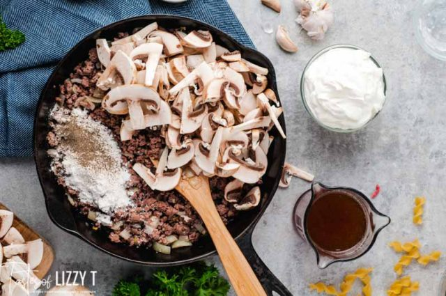 browned ground beef and mushrooms in skillet