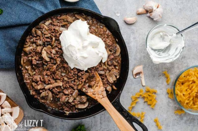 ground beef and mushrooms with sour cream in skillet