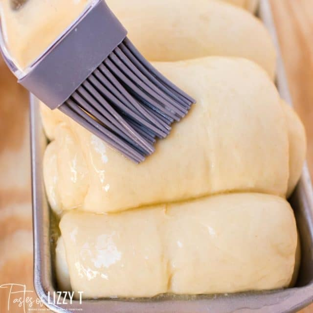pastry brush brushing butter on milk bread