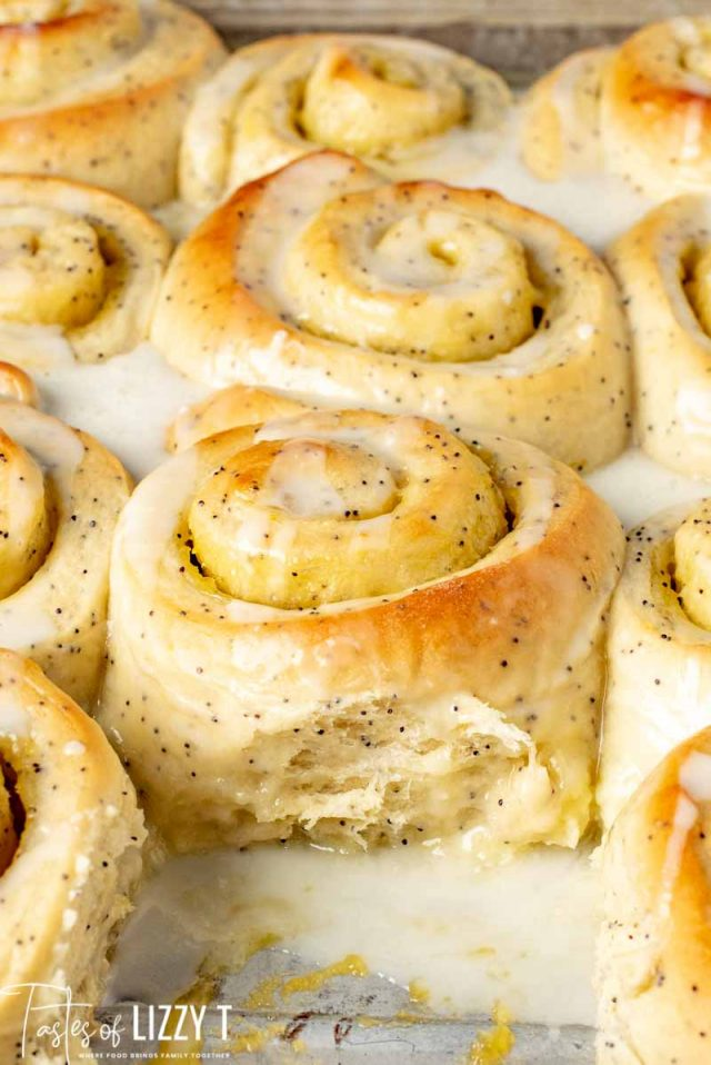 pan of lemon poppy seed sweet rolls with glaze