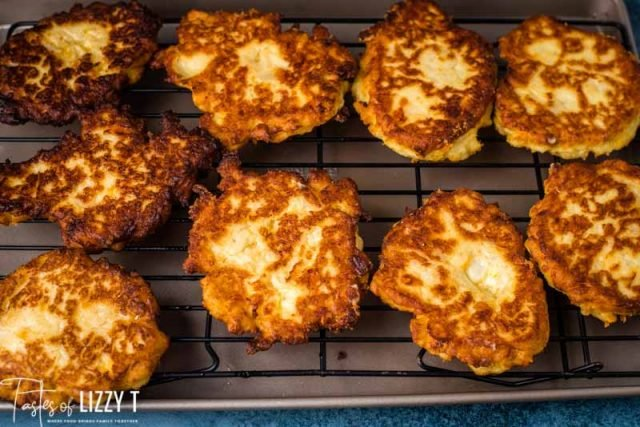 fried potato cakes on a wire rack