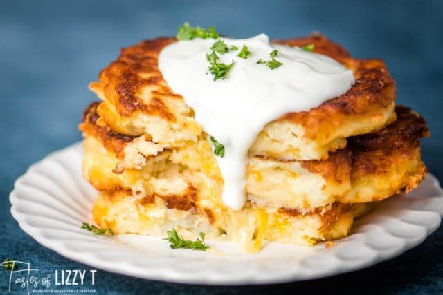 stack of 3 fried potato cakes with sour cream