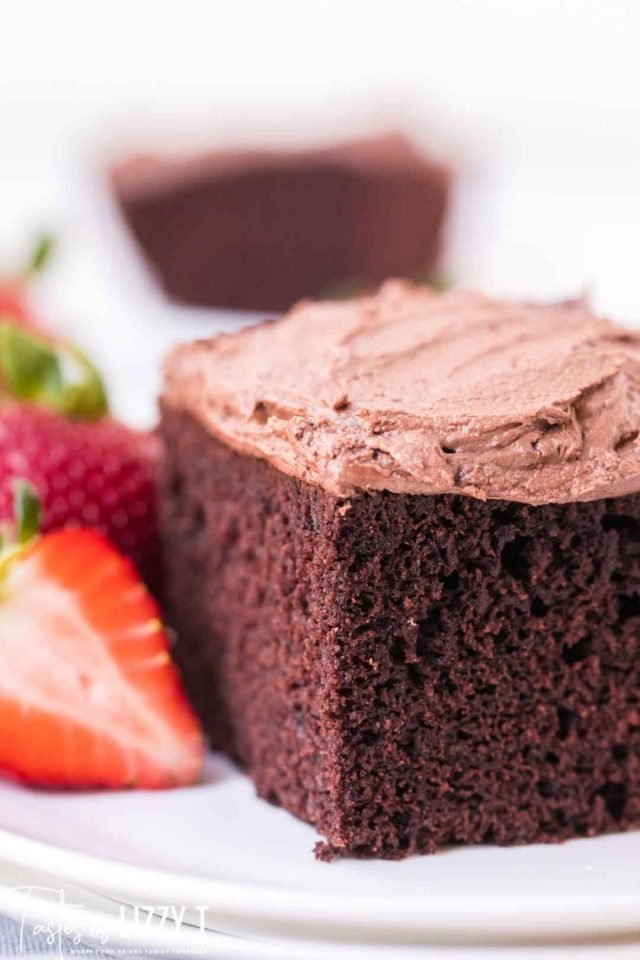 piece of chocolate cake with chocolate frosting and strawberry slices