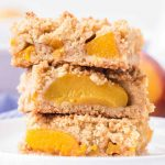 buttery peach crumb bars stacked on each other