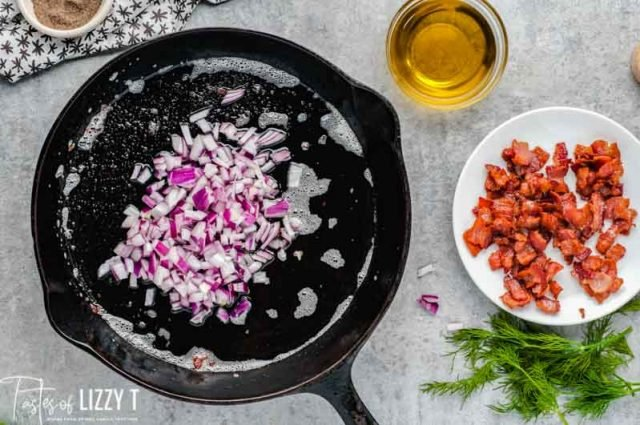 diced red onion in a cast iron skillet