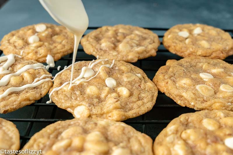 drizzling white chocolate on cookies