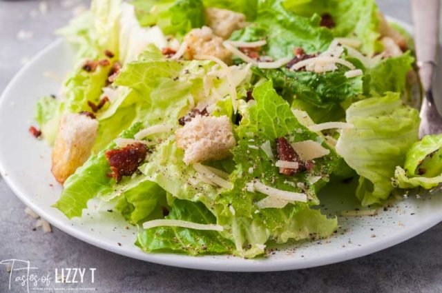 plate of lettuce with croutons, bacon and cheese